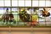 Главный атриум украшен витражами – копиями картин художника Ивана Билибина, чьи иллюстрации к сказкам знакомы всем с детства: «Василиса Прекрасная», «Жар-птица» и др.