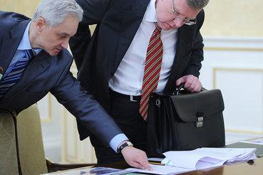 Алексей Кудрин (на фото справа) и помощник президента Андрей Белоусов предлагают по-разному ускорить рост экономики