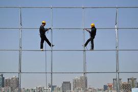 Инвестиции в недвижимость и инфраструктуру поддержали китайскую экономику