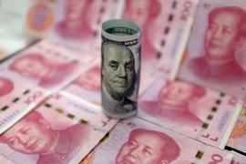 Центробанку приходится приходится противостоять желанию китайцев перевести юани в доллары