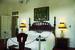 Изголовьем кровати в спальне стали ворота испанского монастыря