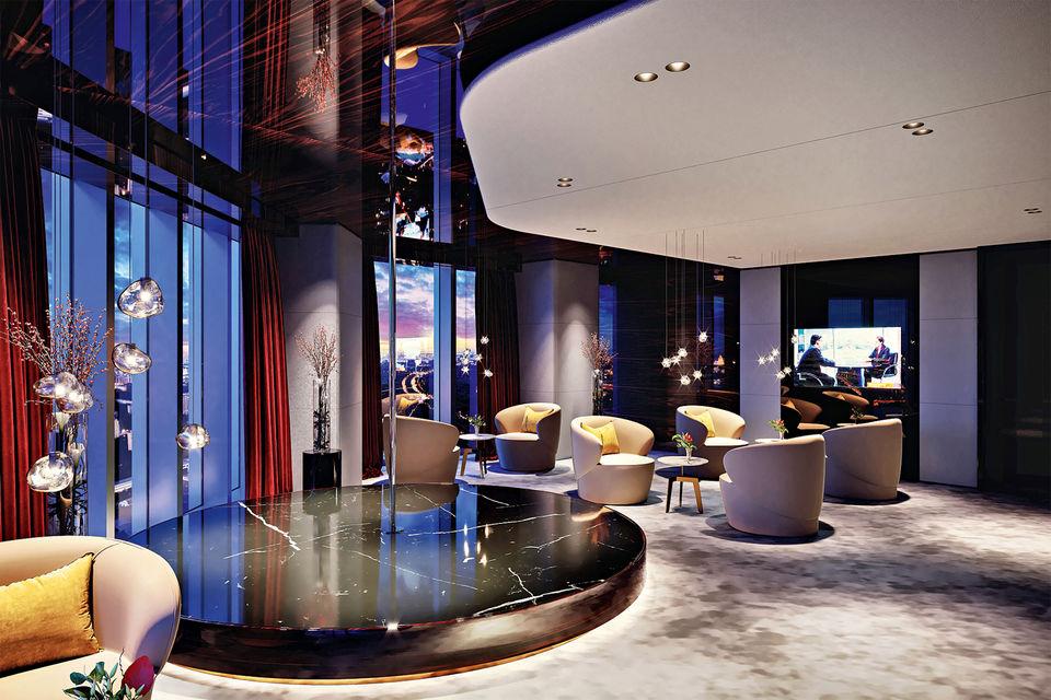 Интерьер лаунж-пространства: помещения отделаны мрамором, натуральной кожей и деревом