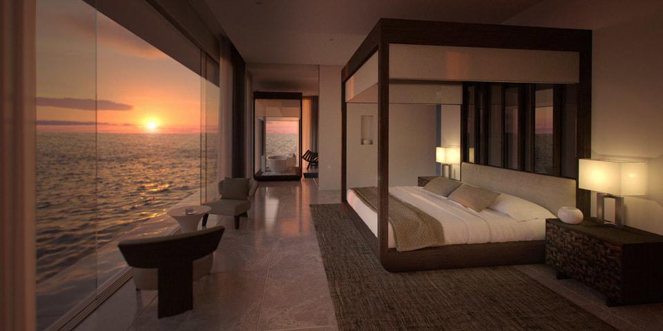 Спальня с видом на океан на верхнем уровне...