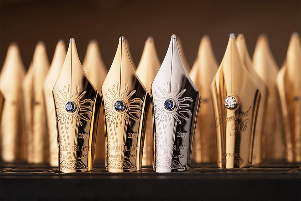 Золотые перья Montblanc, декорированные гравировкой и украшенные бриллиантом или синим сапфиром