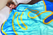 Впервые творческий союз с художником из Лос-Анджелеса Алексом Израэлем французский модный Дом Louis Vuitton заключил на проекте Artycapucines – в его рамках шесть творцов преобразили классическую женскую сумку Capucines. Израэль поместил на нее свой фирменный орнаментальный мотив  вздымающейся волны. Этот мотив в поп-арт-эстетике оказался столь удачным и созвучным современному духу коллекций Дома, что его было решено воспроизвести и на нескольких предметах из текстиля. На шелковых каре и больших одеялах можно видеть все ту же волну в разнообразных  сочетаниях неоновых цветов