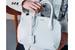 Женская сумка La Prima в коллекции Giorgio Armani – это переосмысленная версия мужской модели 1995 года. C того времени Армани мог не раз убедиться, что «слабому» полу не чужда рациональность, и преобразил удобный мужской аксессуар в женский. В итоге получилась лаконичная функциональная сумка из телячьей кожи palmellato с накладными широкими ручками и округлыми углами. В нынешней коллекции у La Prima шесть вариаций форм: от прямоугольника с короткими ручками, квадрата и прямоугольника с плечевым ремнем до вечерних клатчей. Эти версии «раскрашены» в дюжину цветов, а некоторые из них изготовлены из кожи аллигатора. La Prima имеет все шансы стать новой классикой среди сумок Giorgio Armani