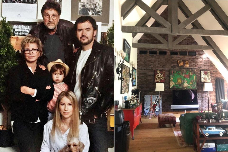 Слева направо: Оксана и Леонид Ярмольник с семьей дочери Александры; хозяйка дома очень любит принимать гостей, поэтому самой просторной комнатой стала гостиная