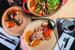 Классический итальянский ресторан Арама Мнацаканова «Рыба» перезапустился ипревратился всовременную суперпиццерию R14, где шеф-пиццайоло Мануэль Сурачи иего команда не только готовят великолепную неаполитанскую пиццу, но ифантазируют на эту тему ивнедряют технологичные приемы. Пиццу Gourmet делают на стыке ресторанной еды иклассики. Враздел Oggi Мануэль постоянно добавляет новинки снеклассической начинкой, например, сезонную пиццу стыквой, коппой истрачателлой. Новую концепцию продолжает исобственный арт-проект Art Hall. Вхолле R14 появилась сменяемая 3 раза вгод экспозиция. Ее наполняют работами молодых италантливых художников Петербурга.